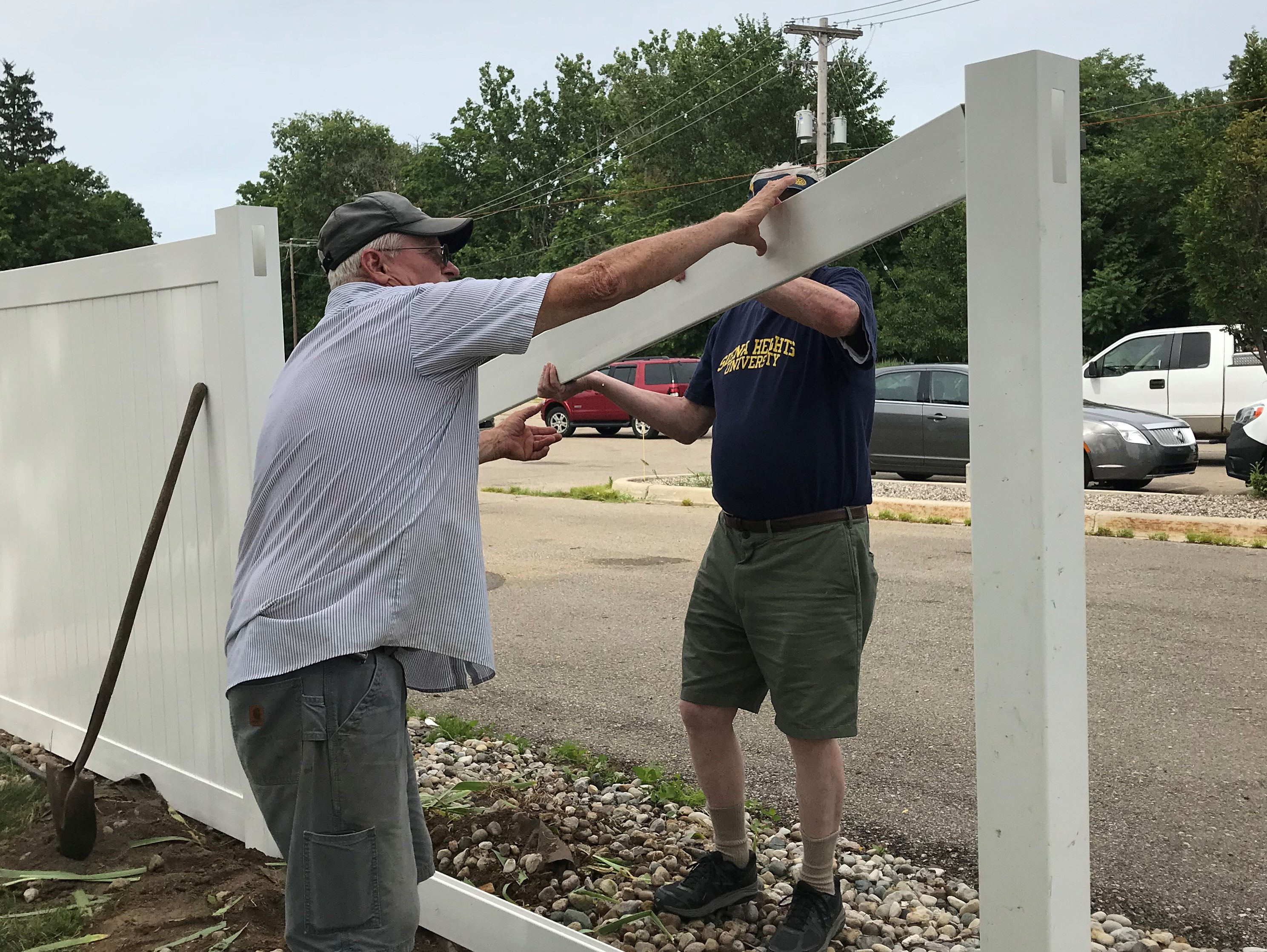 Volunteers build fence for Neighbors of Hope