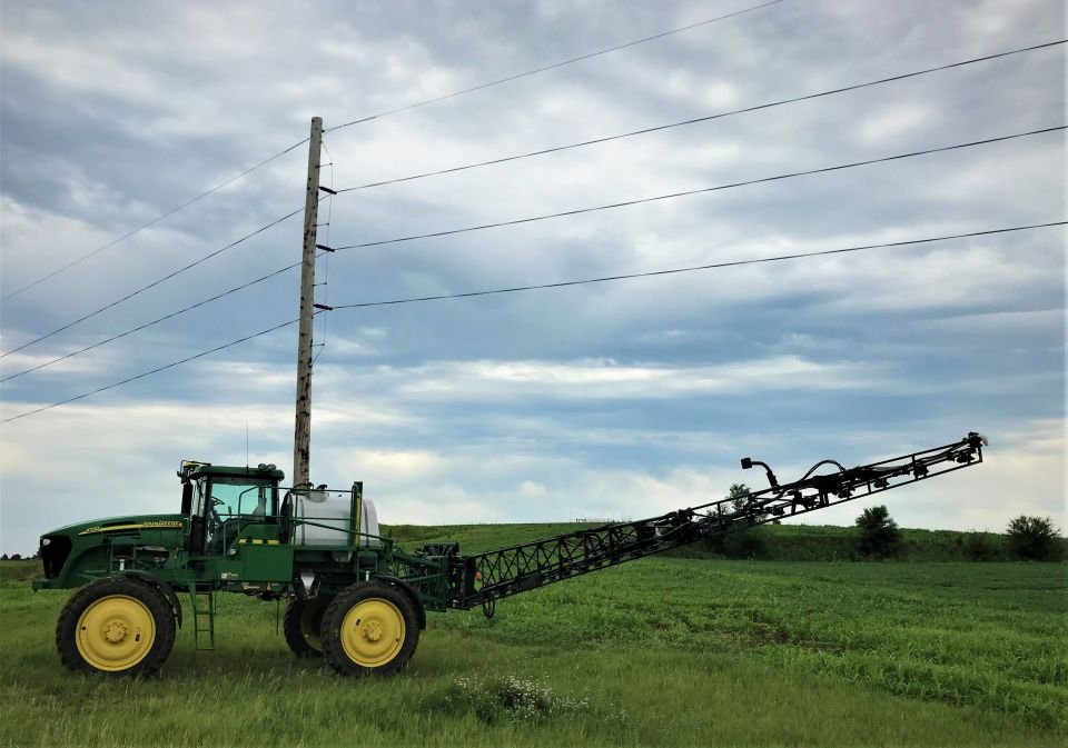 Farm equipment navigating under electric lines